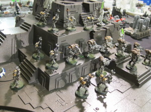 In stark contrast to the Kingbreakers' flaming self-entombment, the Necron basically stand around all day just talkin' about how awesome their fortress is, not even noticing it blasting stuff on its own.