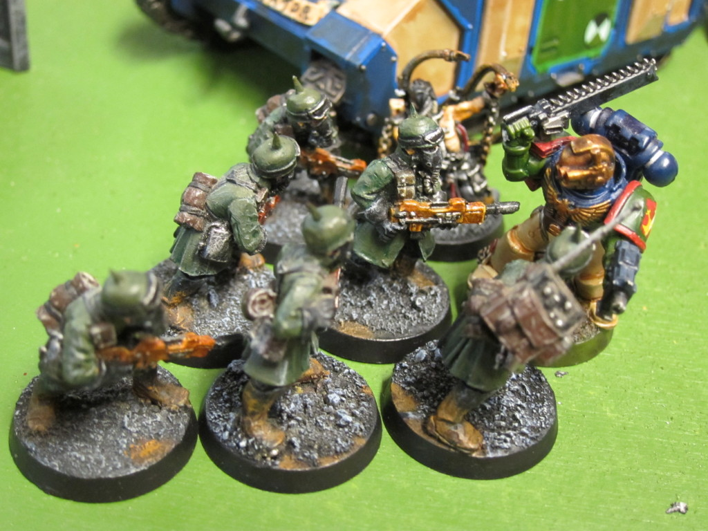 Titus leaps from his Rhino to halt oncoming traitors.