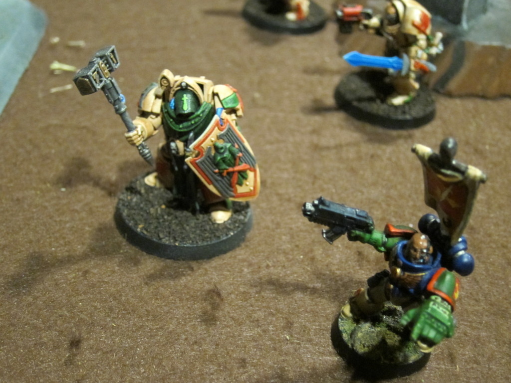 Belial and Scolirus lead the forward charge.