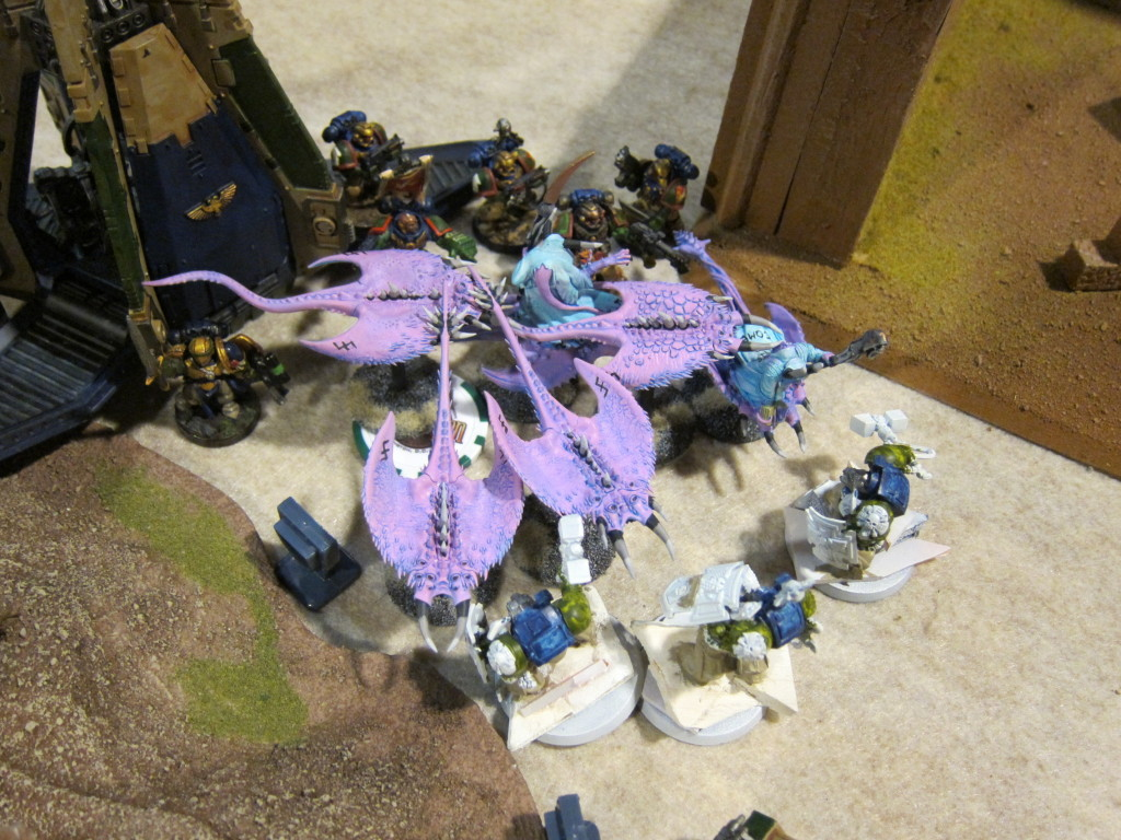 Drop Podding Vulkan and a powerfist combat squad huddle up tight against a combat for blast protection before being able to assist their Terminator battle brothers.
