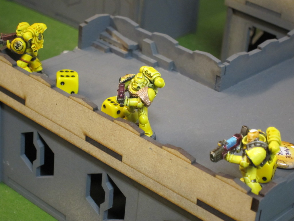 Sentinels of Terra defend a research facility... at the orders of a pack of Daemons...