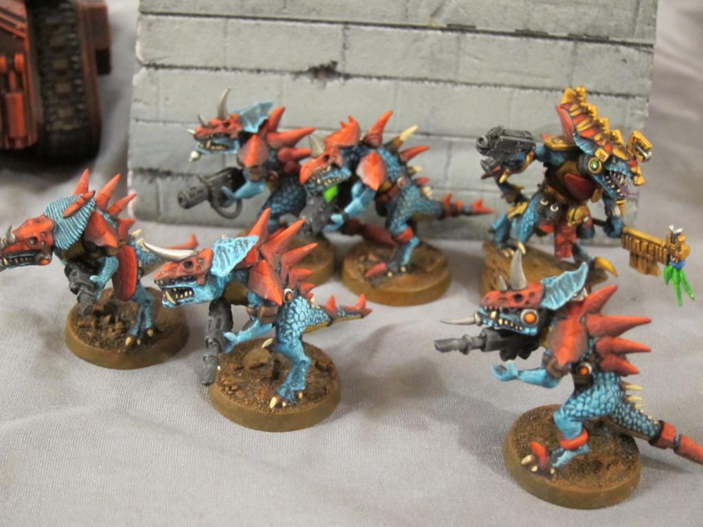 Lizardmen fight against the Imperium that would scorn them.