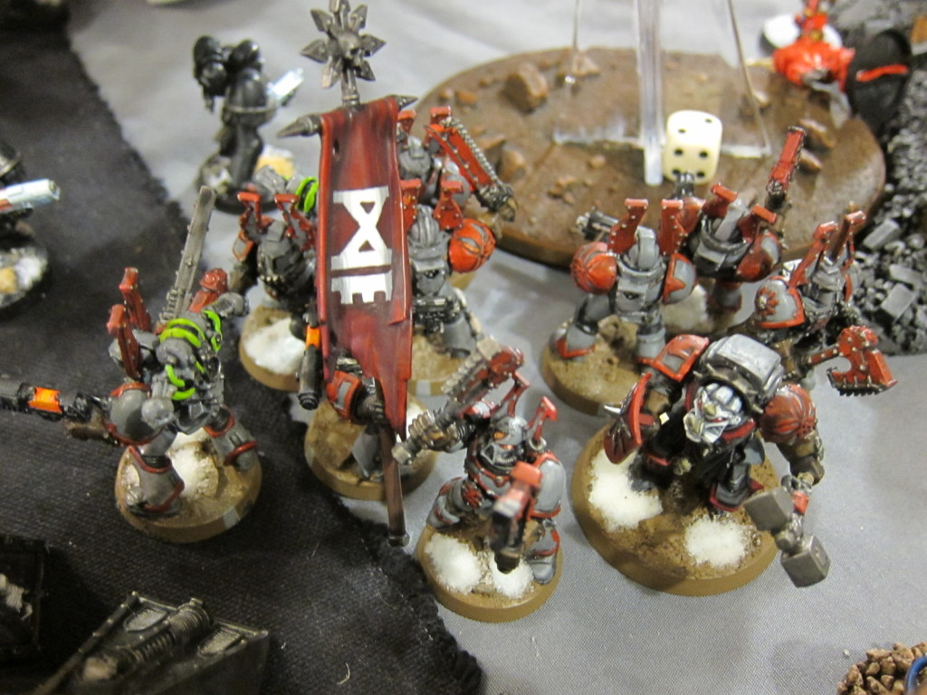 A band of Chaos Marines marches toward the Mechanicum's Strongpoint.