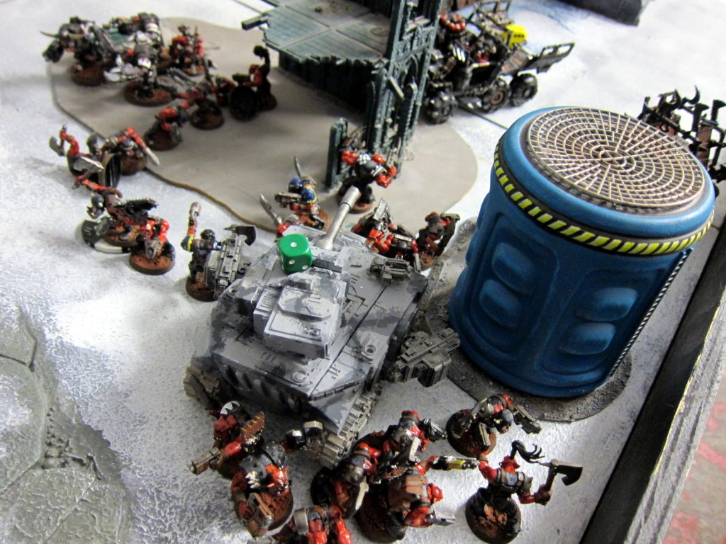 While the Armoured Company as well is mobbed by the Orks.