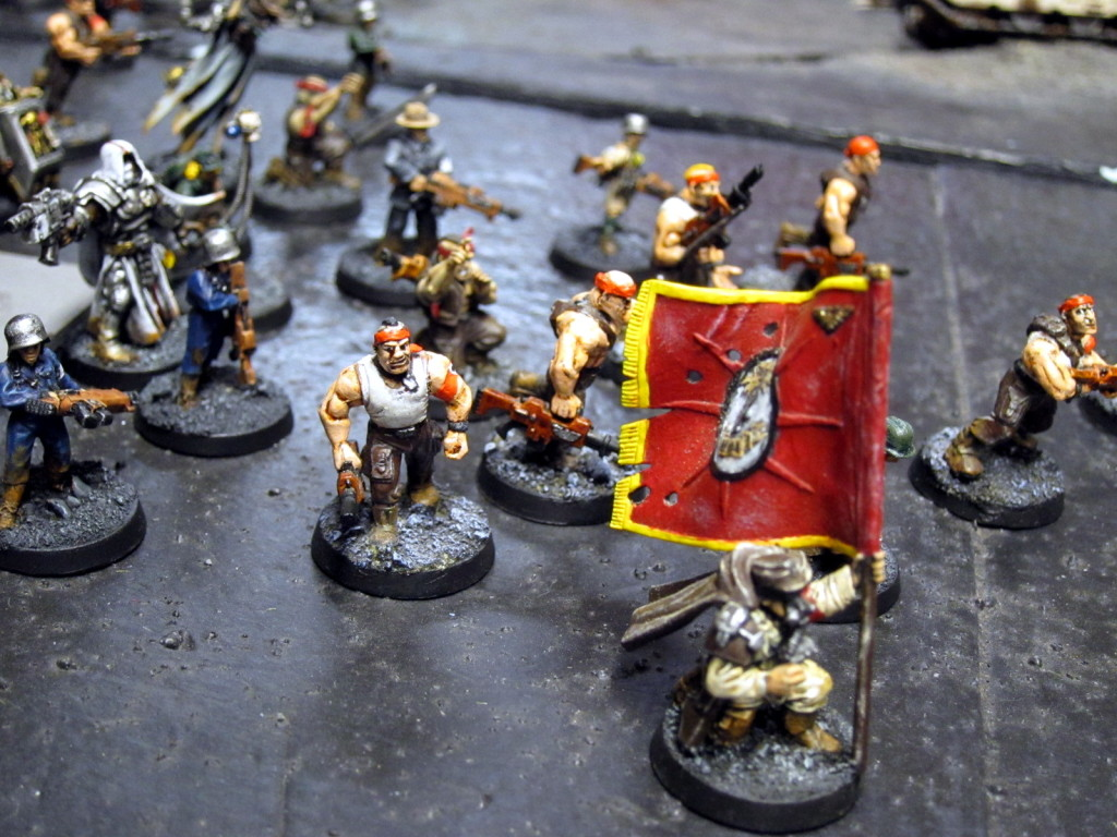 Imperial Guard roustabouts take up arms under the banner of psykers and priests.