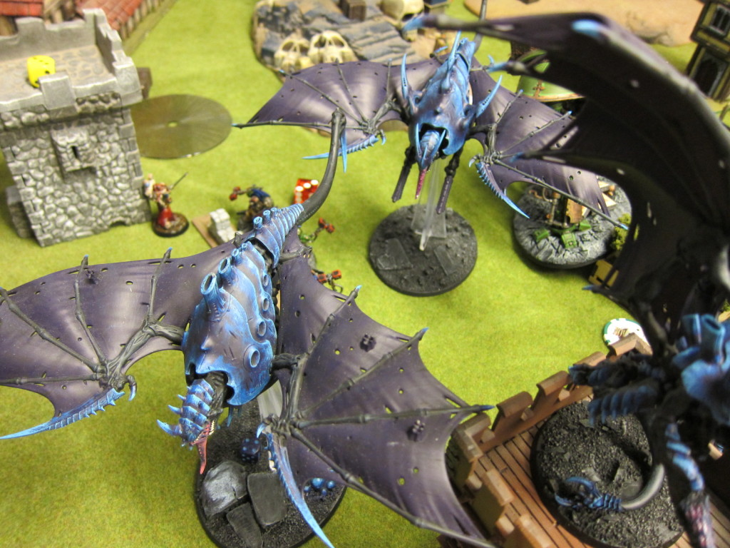 Tyranid swarm over ground defenders far below.