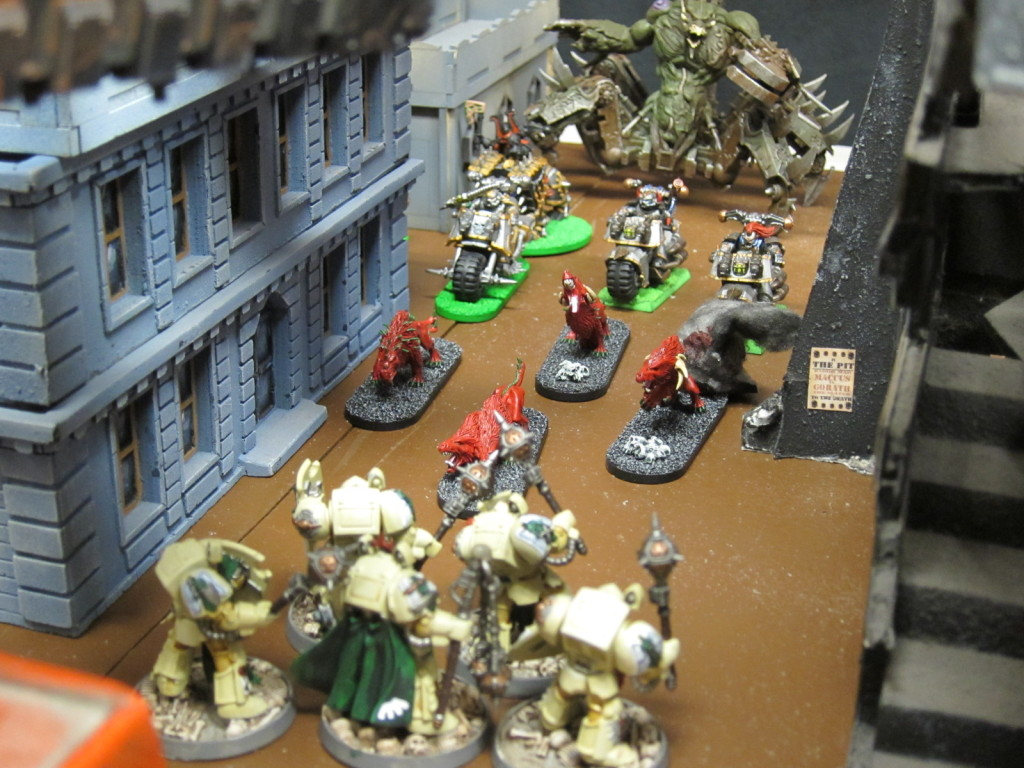 A Soul Grinder exhorts Iron Warriors and Flesh Hounds on through the alleyways toward the Dark Angels' advance.