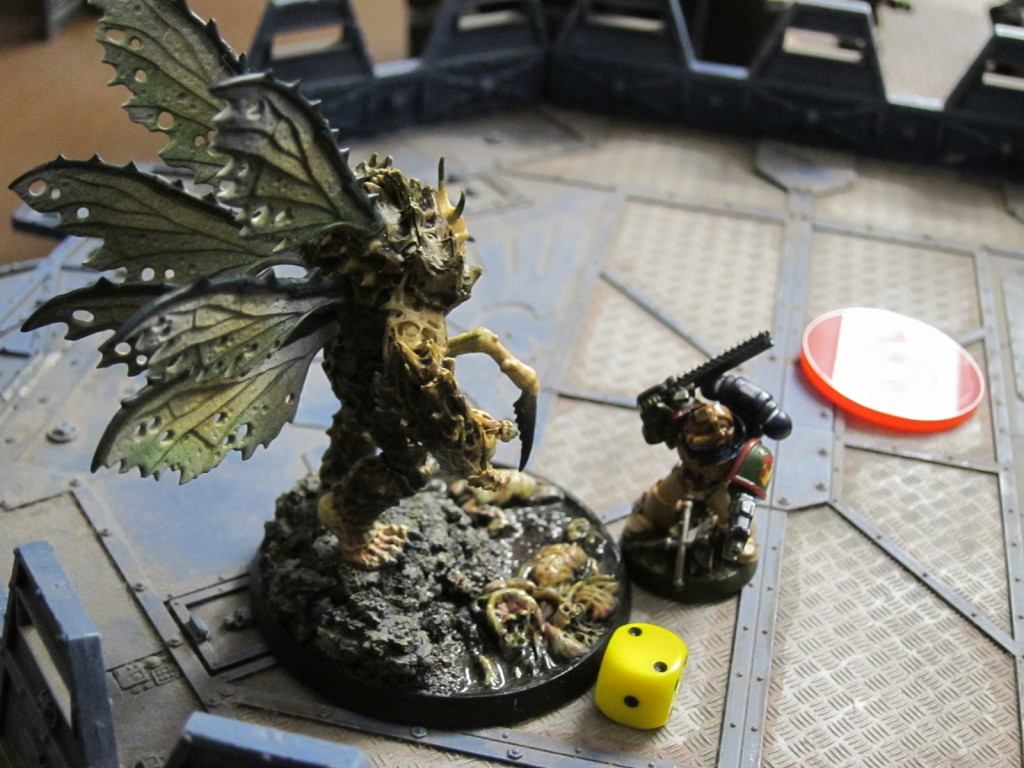 Titus battles the daemon fly to keep it from the control building.