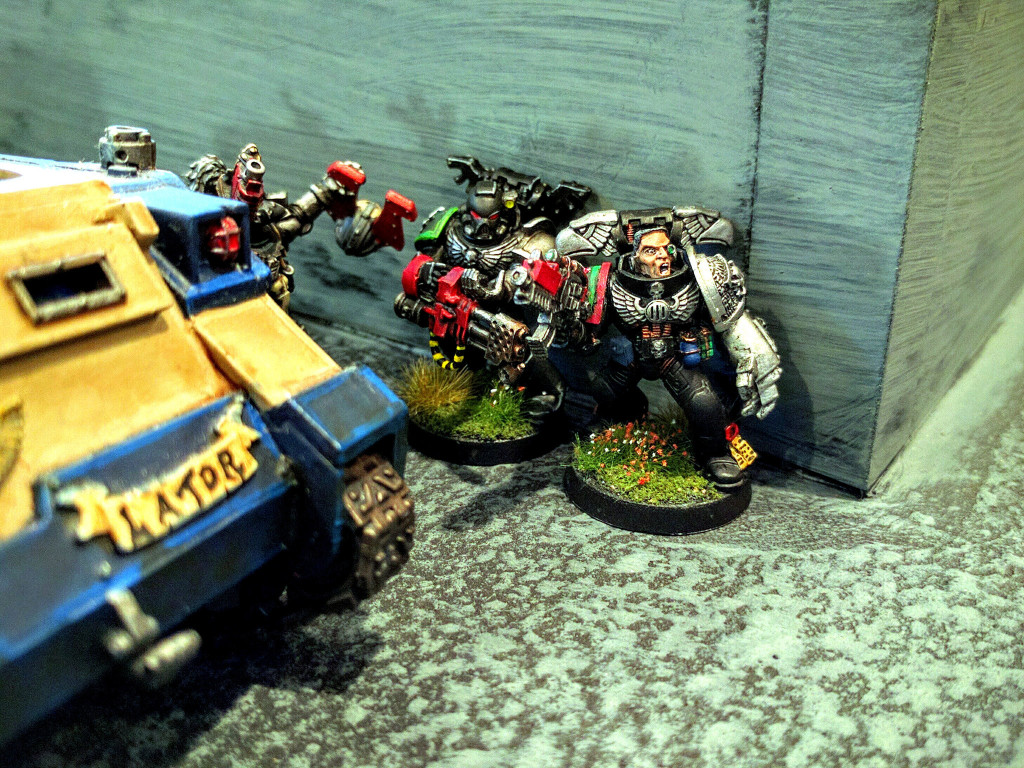 Deathwatch skulk through a complex.