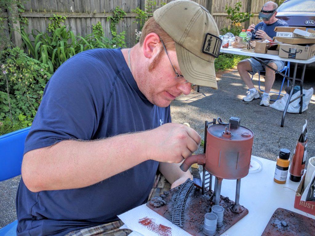 Colin drybrushing ground surfaces.