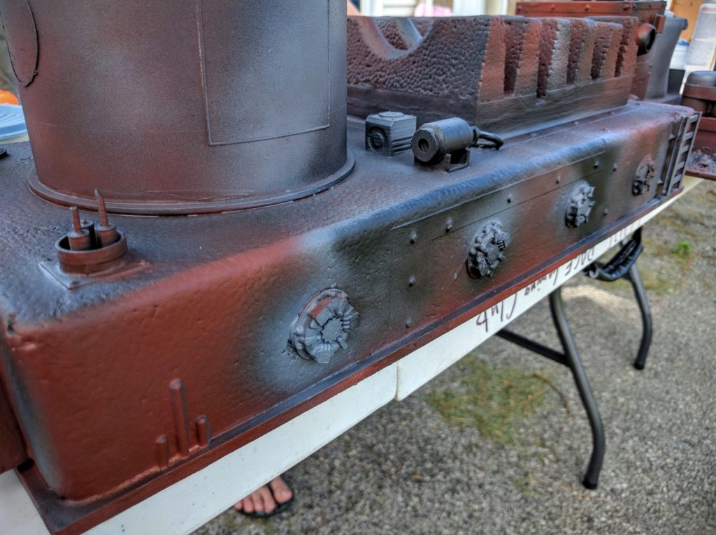 Hatches on the back of the pump station base coated.